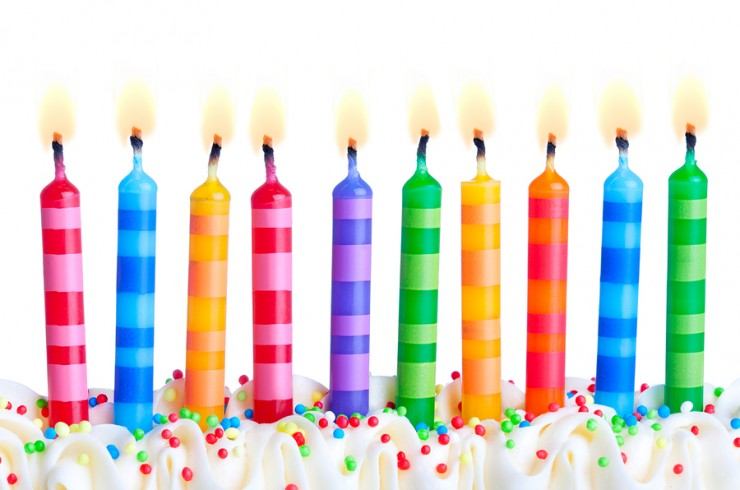 Ten birthday cake candles against a white background